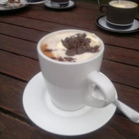 Photo taken at Café Chocolat by Tony B. on 7/31/2013