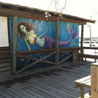 Photo taken at Pirate's Cove Marina & Restaurant by John R. on 4/2/2013