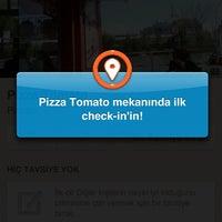 Photo taken at Pizza Tomato by Melis P. on 3/23/2013