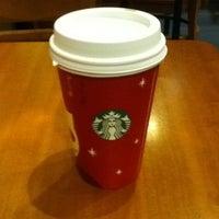 Photo taken at Starbucks by Alex K. on 12/17/2012
