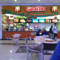 Photo taken at Giraffas by Claudia S. on 1/3/2013