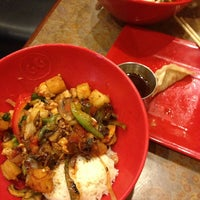 Photo taken at Genghis Grill by Amanda B. on 3/11/2013