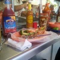 Photo taken at El Primo Pescados Fritos Y Mariscos by Carlos Gibran T. on 12/15/2012