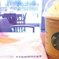 Photo taken at Starbucks by Poompoom K. on 6/9/2012