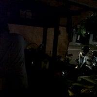 Photo taken at Angkringan Mbah Man by Rori H. on 6/12/2011