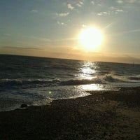 Photo taken at West Beach Selsey by Daniel T. on 8/19/2013