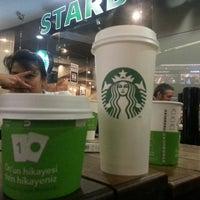Photo taken at Starbucks by Kutay U. on 5/17/2013