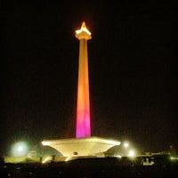 Photo taken at Lapangan Silang Monas by Imel M. on 12/27/2013