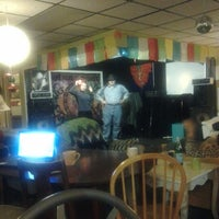 Photo taken at Sacred Grounds Coffee House by Kevin K. on 12/15/2012