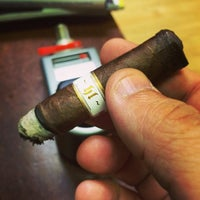 Photo taken at Empire Cigars by Mario T. on 5/26/2014