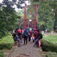 Photo taken at Jembatan Merah Kebun Raya Bogor by Mamio on 11/5/2013