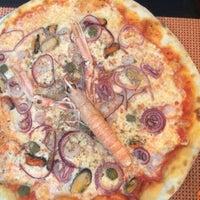 Photo taken at Pizzeria Mirakul by Krisztina R. on 6/24/2015