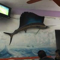 Photo taken at La Jaiba Dorada by Horacio R. on 2/10/2013