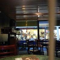 Photo taken at Cosmic Comic Cafe by Sami L. on 1/14/2013