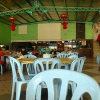 Photo taken at Kampung Seafood by Sidi N. on 3/29/2013