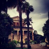 Photo taken at Villa Cortine Palace Hotel by Erik P. on 8/29/2013
