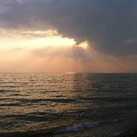Photo taken at Пляж Новофедоровки by Lena S. on 8/14/2013