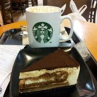 Photo taken at Starbucks by Eunice T. on 10/21/2013