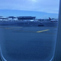 Photo taken at Gate 25 by Justin K. on 1/2/2013