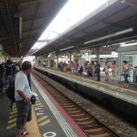 Photo taken at JR Nishikujō Station by Eiji M. on 7/30/2013