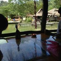 Photo taken at Veg Fish Farm Thai Restaurant (菜园酒家) by Kenny S. on 1/20/2013