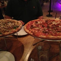 Photo taken at Piecasso Pizzeria & Lounge by Jeremy H. on 3/20/2013