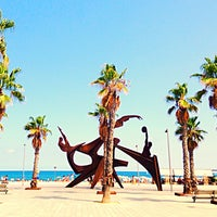 Photo taken at Barceloneta Beach by Dmitry M. on 8/16/2013