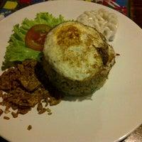 Photo taken at Cafe Asix by Daud K. on 3/16/2013