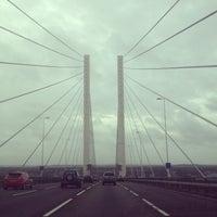 Photo taken at The Queen Elizabeth II Bridge by Belinda D. on 12/23/2012