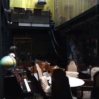 Photo taken at Khaki Cafe Bar by CJ H. on 8/9/2013