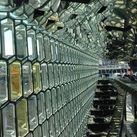 Photo taken at Harpa by Andrew S. on 4/10/2013