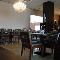 Photo taken at Grand Cafe by sunita p. on 12/3/2013