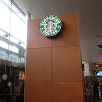Photo taken at Starbucks by Adrien B. on 12/24/2012