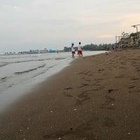 Photo taken at Pantai Pasir Kencana by Om J. on 1/10/2016