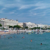 Photo taken at Plage de la Croisette by Kateryna on 6/29/2013