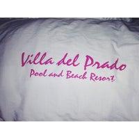 Photo taken at Villa del Prado Pool and Beach Resort by Gen M. on 12/31/2013