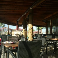 Photo taken at Tropikal Cafe & Nargile by Mustafa C. on 1/17/2013