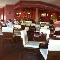 Photo taken at Wakame Sushi & Asian Bistro by Razia A. on 5/12/2013