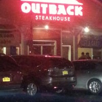 Photo taken at Outback Steakhouse by Kiu K. on 12/30/2012