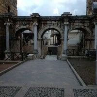Photo taken at Hadrian's Gate by Şenol on 2/10/2013