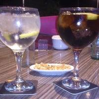 Photo taken at Tharsiss Lounge Bar by Nacho H. on 9/18/2013