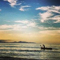 Photo taken at Praia de Itapoá by Djessica D. on 7/10/2013