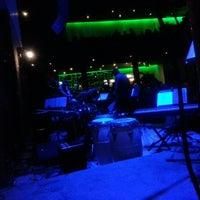 Photo taken at Jazz Café by Fabiana C. on 12/21/2012