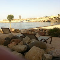 Photo taken at Palm City Rocky Beach by Djordje R. on 6/25/2014