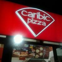 Photo taken at Caribic Pizza by Svetlana P. on 1/24/2013