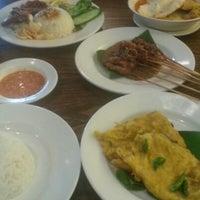 Photo taken at Kafe Betawi by Yuri E. on 3/24/2013