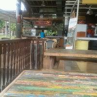 Photo taken at Rumah Makan Apung by Aini C. on 3/5/2014