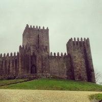 Photo taken at Muralhas da Cidade de Guimarães by Rômulo Z. on 1/31/2014