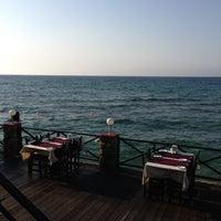 Photo taken at Calamari Restaurant by Bihter Asena Y. on 6/27/2013