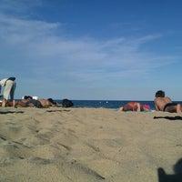 Photo taken at Bogatell Beach by Marina on 7/29/2013